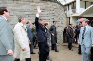 President_Reagan_waves_to_crowd_immediately_before_being_shot_1981